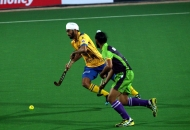 Punjab Warriors and Delhi Waveriders players in action  during Hero Hockey India League 2013 at Delhi on 14th Jan 2013.