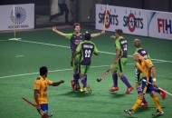 Delhi Waveriders celebrating after hitting a goal.