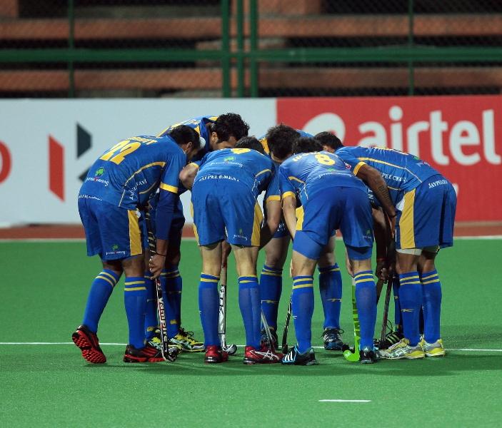 Jaypee Punjab warriors team huddle during the match