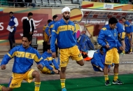 gurmail-singh-player-of-punjab-warriors-during-wamup-session-along-with-team-mates-at-delhi-on-29th-jan-2013