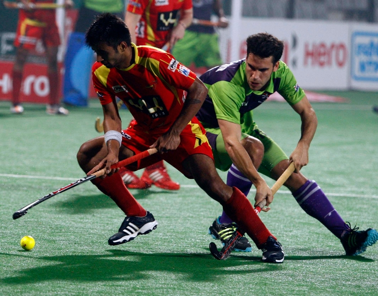 ranchi-rhinos-and-delhi-waveriders-player-in-action-during-the-match-between-ranchi-rhinos-and-delhi-waveriders-at-delhi-on-30th-jan-2013-3
