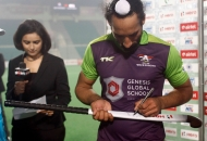 sardar-singh-sign-hockey-stick-during-presentation-ceremony