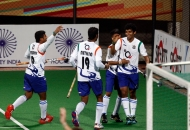 uttar-pradesh-wizards-team-celebrates-after-the-goal-against-delhi-waveriders-at-delhi-on-7-feb-2013_0