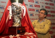 Managing Director & CEO of Hero MotoCorp Ltd Mr. Pawan Munjal with the Hero Hockey India League Trophy