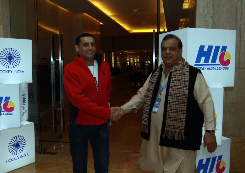 Dr. Narinder Batra, Secretary General Hockey India and Chairman Hockey India League with Amit Burman, owner Mumbai Magicians