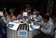 Ranchi Rhinos owners look at the Players profile during the Hockey India League Players Auction on 16.12.2012