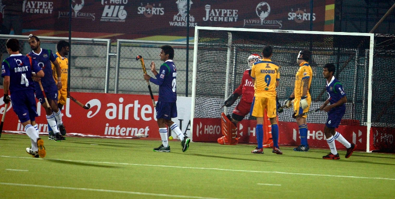 raghunath-skipper-of-up-wizards-scoring-a-second-goal-for-up-wizards-against-punjab-warriors-at-jalandhar-on-22nd-jan-2013-2