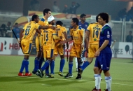 punjab-warriors-celebrating-their-second-goal-against-up-wizards-match-at-jalandhar-on-22nd-jan-2013-1