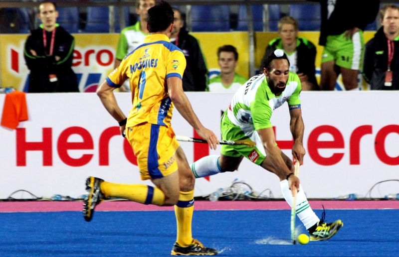 Sardar Singh captain of DWR and Jamie Dwyer captain of JPW in action in the match
