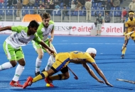 Gurmail Singh of JPW in action against DWR in HHIL 2014 match on 25th Jan 2014 at mohali