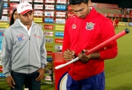 VR Raghunath captain of the winning team UPW signing hockey stick
