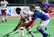 DMM player sarvanjit singh in action with HUGO Inglis