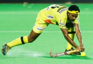 birendra-lakra-player-of-rr-in-action-against-dmm-2