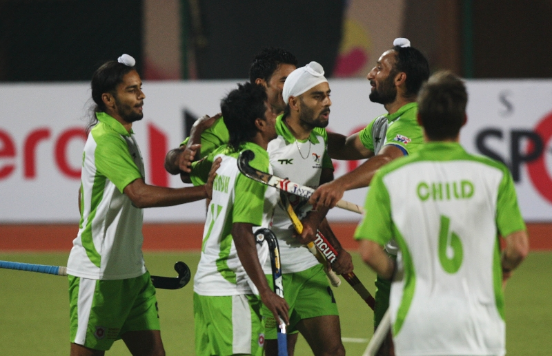delhi-wave-rider-players-celebrating-third-goal-against-of-ranchi-rhinos-team-during-11-match-of-hhil-2013-at-astroturf-hockey-stadium-on-date-23-jan-2013