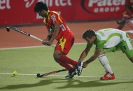 ranchi-rhinos-players-and-delhi-wave-riders-players-in-action-during-11th-match-of-hhil-at-astroturf-hockey-stadium-ranchi-on-date-23-jan-2013-6