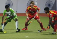 ranchi-rhinos-players-and-delhi-wave-riders-players-in-action-during-11th-match-of-hhil-at-astroturf-hockey-stadium-ranchi-on-date-23-jan-2013-7