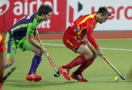 ranchi-rhinos-players-and-dwr-player-in-action-during-22nd-match-of-hhil2013-at-astroturf-hockey-stadium-at-ranchi-on-date-1-feb-2013-2