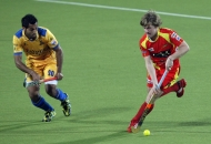 ashley-jackson-in-red-jersey-of-rr-and-dharmveer-singh-in-yellow-in-action-during-24-match-of-hhil2013-at-ranchi