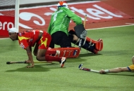 mandeep-singh-in-red-in-action-match-no-24-of-hhil2013