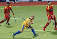rr-player-and-jpw-player-in-action-during-24th-match-of-hhil2013-at-ranchi