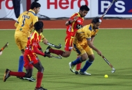 rr-player-in-red-and-jpw-player-in-yellow-in-action-during-24-match-of-hhil2013-at-ranchi