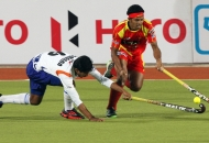 birender-lakra-rr-plyer-in-red-jersey-in-action-during-12-match-of-hhil-2013-between-rr-and-upw-at-astroturf-hockey-stadium-ranchi-on-date-24-jan-2013