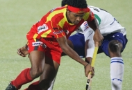 birender-lakra-rr-plyer-in-red-jersey-in-action-during-12-match-of-hhil-2013-between-rr-and-upw-at-astroturf-hockey-stadium-ranchi-on-date-24-jan-2013_0
