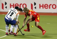 ranchi-rhinos-players-and-uttar-pradesh-wizard-team-players-in-action-during-12th-match-of-hhil-2013-at-astroturf-stadium-ranchi-on-date-24-jan-2013-4