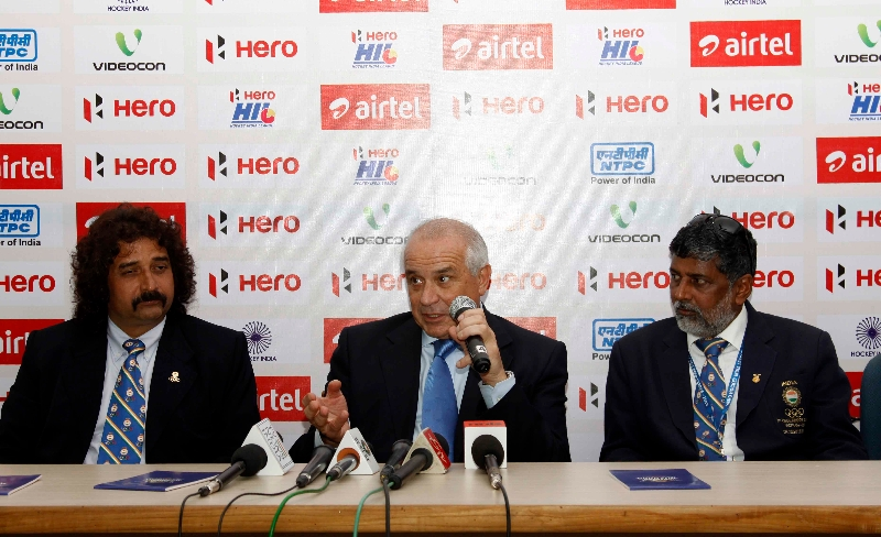 leandro-negre-president-of-federation-of-international-hocley-in-middle-alond-with-r-b-singh-in-right-side-during-post-match-press-conference-at-lucknow-on-3rd-feb-2013