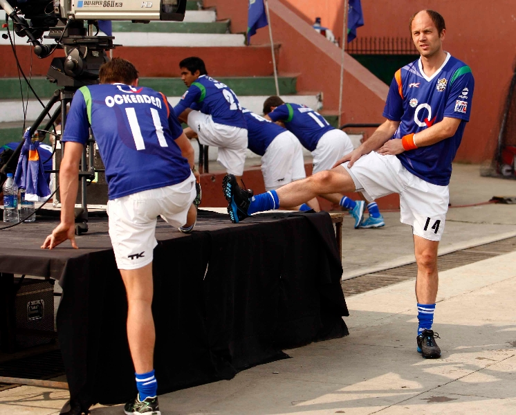 teun-de-noijer-of-upw-along-with-other-players-during-warmup-session-at-lucknow-on-3rd-feb-2013