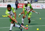 dwr-player-imran-khan-and-talwinder-singh-warming-up-their-body-before-match-at-lucknow-on-3rd-feb-2013