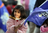 little-girl-with-upw-flag-support-their-team-during-the-match