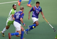 upw-player-luke-doerner-with-sardar-singh-in-action-during-the-match-at-lucknow-on-3rd-feb-2013