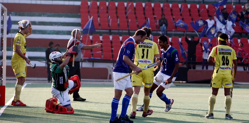 Raghunath captain of UP Wizards scoringa-second goal for UP Wizards against Rhinos match at lucknow on 20th Jan 2013 (Pic-3)