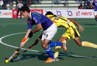 UP Wizards and Ranchi Rhinos player in action during the match